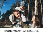happy family standing on the... | Shutterstock . vector #611858216
