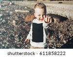 fashionable child on the beach.... | Shutterstock . vector #611858222