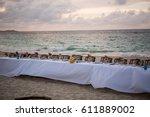beach front dinner | Shutterstock . vector #611889002