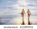 surfer girls at berawa beach ... | Shutterstock . vector #611890922