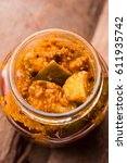 Small photo of Homemade Mango Pickle or aam ka achar or achaar in aglass jar, selective focus