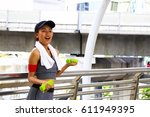 smiley face of sporty woman is... | Shutterstock . vector #611949395