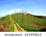 windmill and power lines near a ... | Shutterstock . vector #611955812