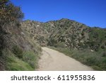 dirt road leading up a hill... | Shutterstock . vector #611955836