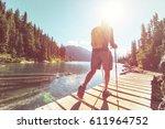 hiking man in canadian... | Shutterstock . vector #611964752