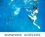 woman snorkeling with while... | Shutterstock . vector #612011432