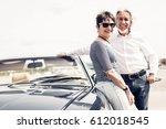 senior couple standing next to... | Shutterstock . vector #612018545