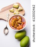 Small photo of Homemade Mango Pickle or aam ka achar or achaar in white bowl, selective focus