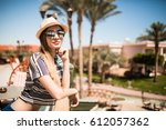 rear view of female tourist ... | Shutterstock . vector #612057362