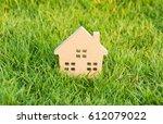 wooden house on green grass  ... | Shutterstock . vector #612079022