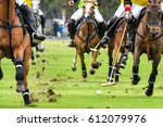 Stock photo horses running in a polo game 612079976