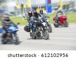 fast moving bikers in motion... | Shutterstock . vector #612102956