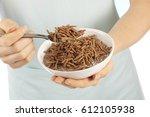 woman eating all bran breakfast ... | Shutterstock . vector #612105938