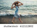happy attractive brunette... | Shutterstock . vector #612112802