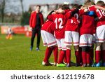 coach giving children's soccer... | Shutterstock . vector #612119678