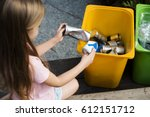 little kids separating recycle... | Shutterstock . vector #612151712