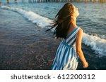 brunette beautiful woman enjoy... | Shutterstock . vector #612200312