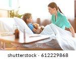 cute little girl lying in... | Shutterstock . vector #612229868