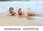 three young girls in a bikini... | Shutterstock . vector #612245216