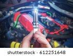 mechanic holds a spare part... | Shutterstock . vector #612251648