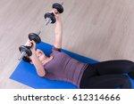 slim sporty woman doing... | Shutterstock . vector #612314666