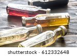 bottles with different kinds of ... | Shutterstock . vector #612332648