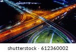 Small photo of Night scene of transportation infrastructure at T-junction with the overpass, aerial view, Thailand