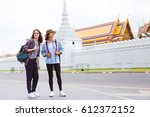 two girlfriends traveling to... | Shutterstock . vector #612372152