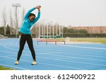 young bent woman training on... | Shutterstock . vector #612400922