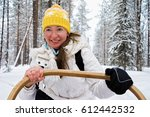 girl riding husky dogs sledge... | Shutterstock . vector #612442532
