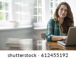 Smiling Woman With Laptop In...