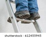 a man stands on a ladder | Shutterstock . vector #612455945