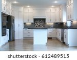 Stock photo full view of empty black and white modern kitchen 612489515