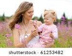 mother and daughter in meadow...   Shutterstock . vector #61253482