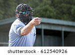 Umpire in blue uniform calls a...