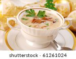 traditional polish mushroom soup with cream for christmas in white elegance dishware - stock photo