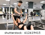 personal trainer helping a... | Shutterstock . vector #612619415