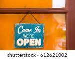 sign come in we're open on the... | Shutterstock . vector #612621002