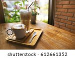 a cup of hot latte coffee and... | Shutterstock . vector #612661352
