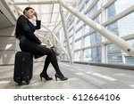 businesswoman sitting on carry... | Shutterstock . vector #612664106