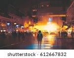 man standing on street looking... | Shutterstock . vector #612667832