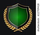 golden shield with laurel... | Shutterstock . vector #612709418