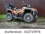 big powerful atv at fence | Shutterstock . vector #612715976