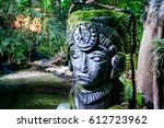 head statue covered with moss | Shutterstock . vector #612723962