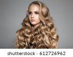 portrait of a beautiful young... | Shutterstock . vector #612726962
