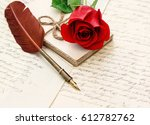 Stock photo red rose flower old letters and antique feather pen vintage style background undefined blurred 612782762
