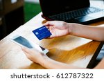woman hands holding credit card ... | Shutterstock . vector #612787322