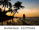 female beachgoer looking into... | Shutterstock . vector #612791666