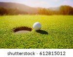 golf ball on lip of hole over... | Shutterstock . vector #612815012