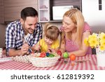 happy family painting easter... | Shutterstock . vector #612819392